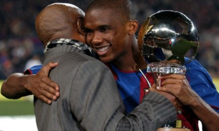 Barcelona's Samuel Eto'o recieves his African Footballer of the Year Award from his father before the game against Real Mallorca
